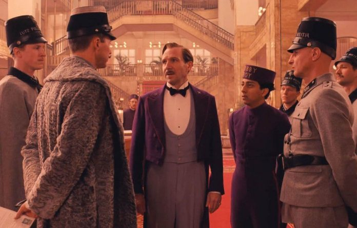Wes Anderson's The Grand Budapest Hotel stars Ralph Fiennes as a concierge who is accused of murder.