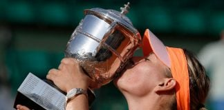 Russia's Maria Sharapova kisses the Suzanne Lenglen trophy after winning her French Open final match against Romania's Simona Halep at Roland Garros in Paris.