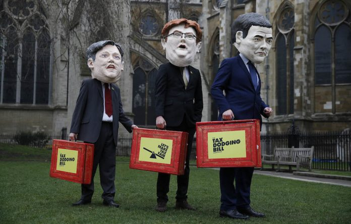 Campaigners for a tax dodging Bill dressed up as some of Britain's chief political henchmen. The campaign calls for multinationals to pay their 'fair' share of tax.