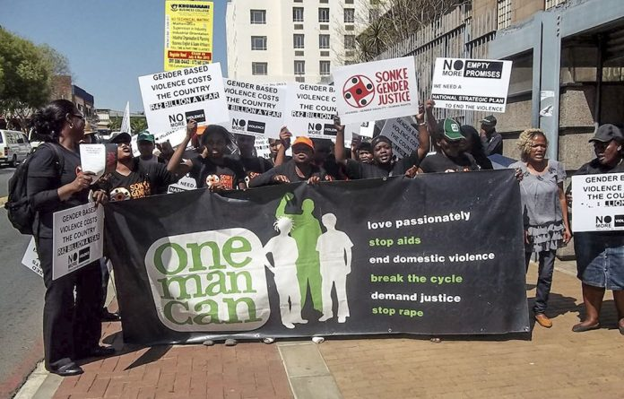Enough is enough: Sonke Gender Justice protests outside the court where the sjambok-wielding Patrick Wisani appeared.