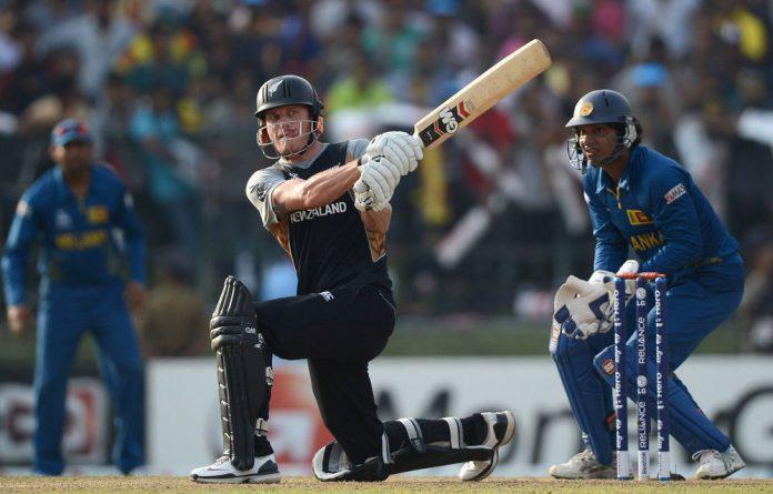 Rob Nicol of New Zealand hits out for six runs watched by Sri Lanka wicketkeeper Kumar Sangakkara during the ICC World Twenty20 match between Sri Lanka and New Zealand.