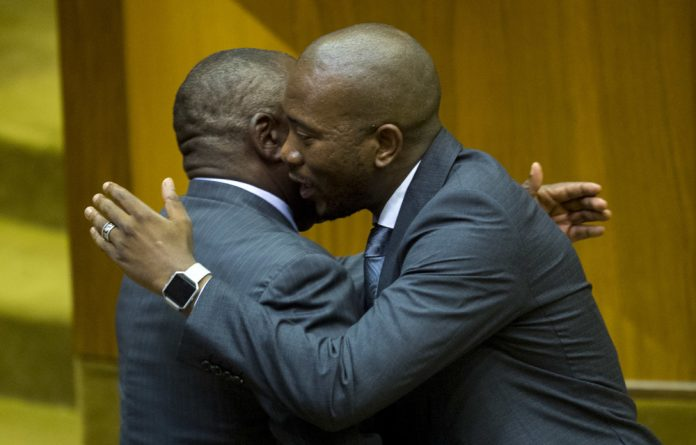 Cyril Ramaphosa is congratulated by DA leader Mmusi Maimane after being sworn in as the new president of the Republic of South Africa in Parliament on February 15 2018 in Cape Town.