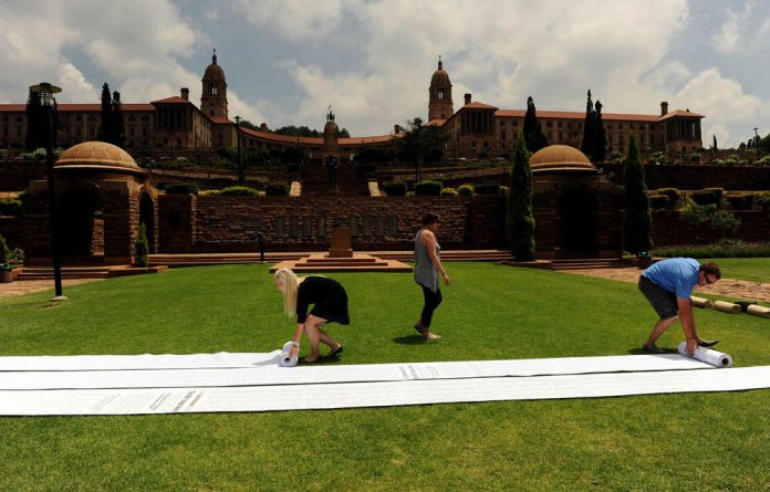Afriforum youths roll out petition rolls spanning more than a kilometre on the presidential lawn in front of the Union Buildings in Pretoria.