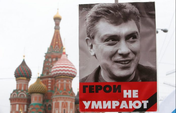 Tens of thousands of people marched in central Moscow on Sunday to honour slain opposition leader Boris Nemtsov