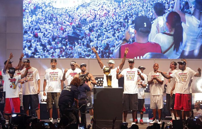 Players of the Miami Heat celebrate the NBA Championship victory rally at the AmericanAirlines Arena in Miami on June 24.