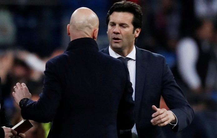 Real Madrid coach Santiago Solari shakes hands with Ajax coach Erik ten Hag at the end of the match.