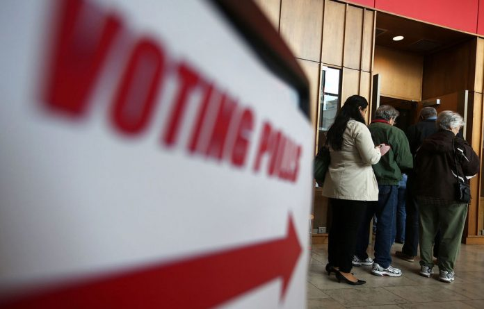 Voters wait in line to participate in early votingat the Silver Spring Civic Building in Silver Spring