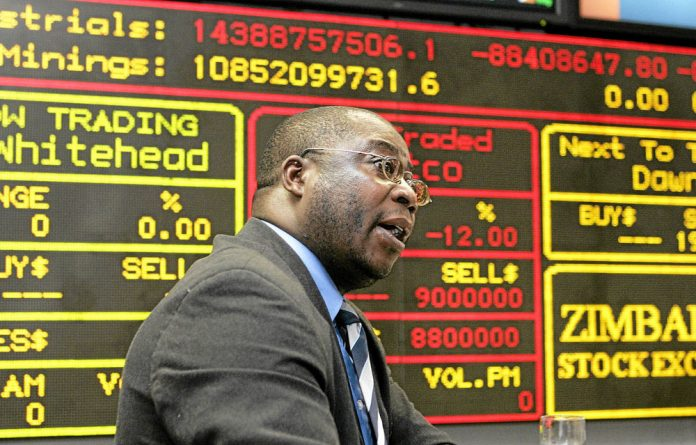 Uncertain times: A broker makes a bid at the Zimbabwe Stock Exchange.
