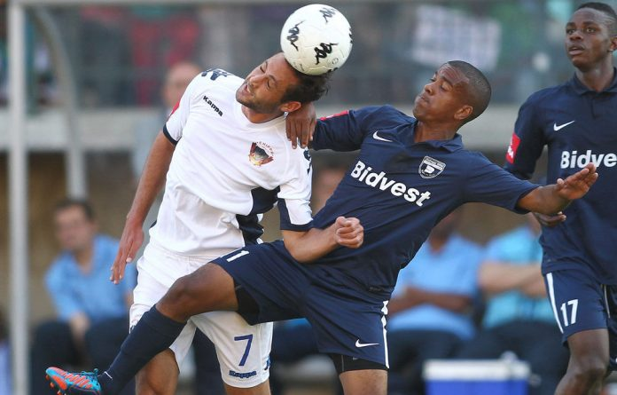 Larry Cohen of Chippa United FC wins the ball as Erwin Isaacs of Bidvest Wits challenges during the Absa Premiership match between Chippa United and Bidvest Wits.