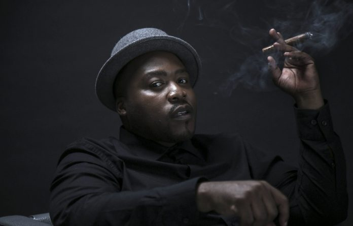 Smokin: Stogie T pushes the envelope of the rap genre by his intelligent references to current affairs