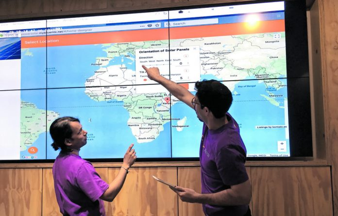 IBM research scientists Toby Kurien and Ashley Gritzman demonstrate the EmpowerSolar app at its launch in April and an example of the information it collates.