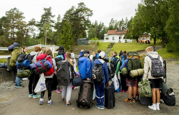 Moving on: Youths arrive on Utøya for a ­summer camp