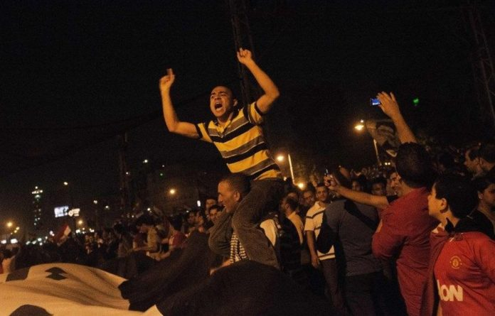 Hundreds of thousands of Egyptians demonstrate outside the presidential palace protesting against President Mohamed Morsi and the Muslim Brotherhood.