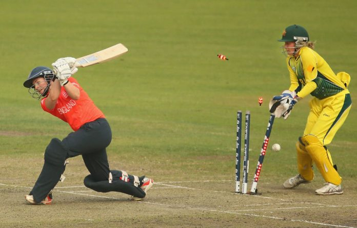 Tammy Beaumont of England is bowled out by Sarah Coyte of Australia during the final of the ICC Women's World Twenty20.