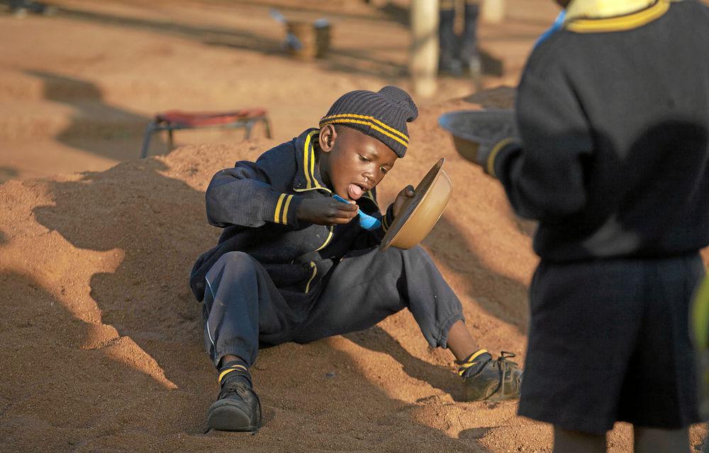 Schoolchildren receive porridge as part of the school feeding scheme in Limpopo.