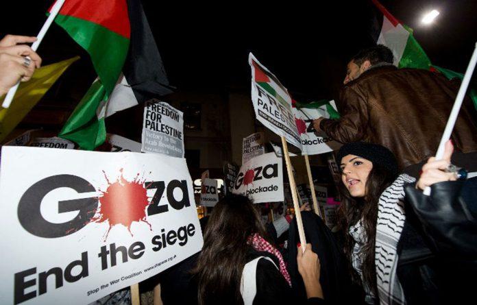 Pro-Palestinian demonstrators protest near the Israeli embassy in central London on November 15 2012