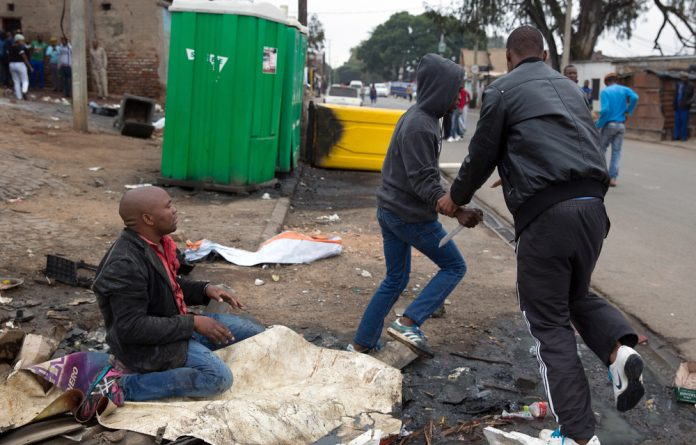 Photojournalist James Oatway captured the attack on Emmanuel Sithole