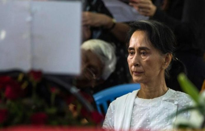 Aung San Suu Kyi looks down