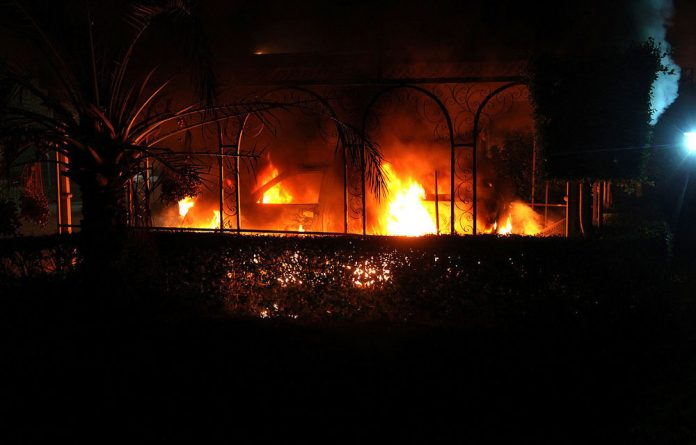 An armed mob protesting over a film they said offended Islam attacked the US consulate in Benghazi on Tuesday and set fire to the building