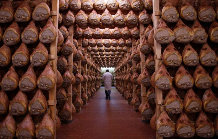 Gourmet's delight:A special room where the hams are hung to dry in Langhirano near Parma.