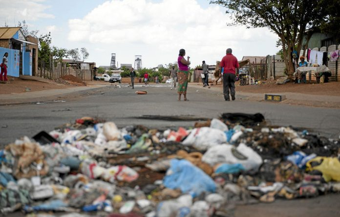 Bekkersdal roads are filled with sewage and rocks.