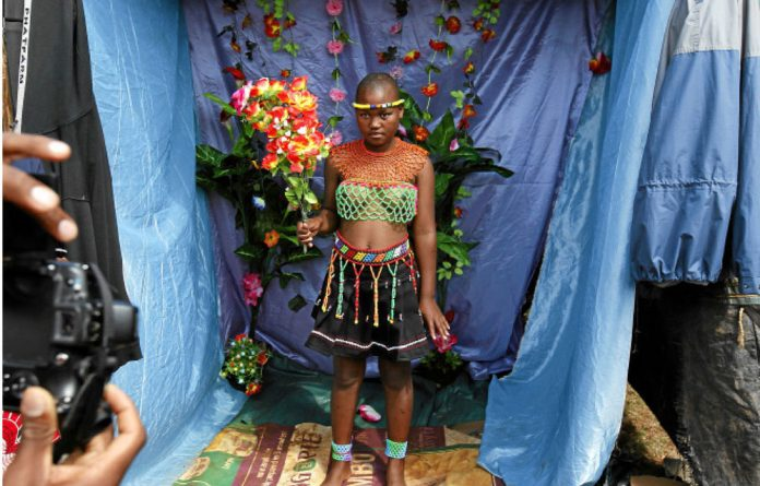 A Swazi maiden poses in a makeshift studio before last year's reed dance.