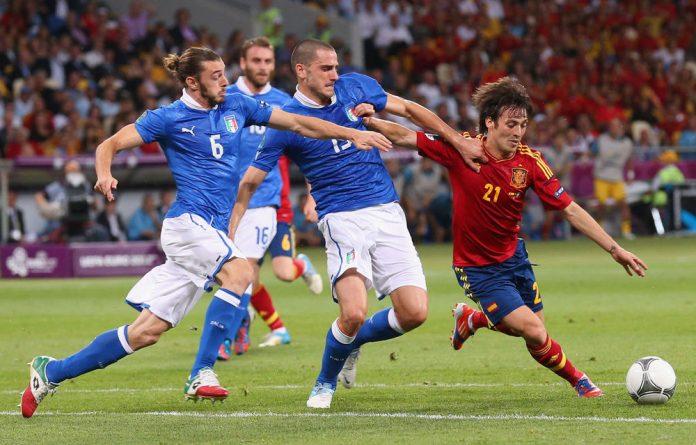 Federico Balzaretti and Leonardo Bonucci of Italy challenge David Silva of Spain during the Uefa Euro 2012 final match between Spain and Italy.