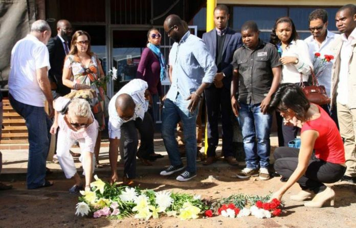 Mourning: Mozambicans pay their respects to Gilles Cistac who was gunned down outside a restaurant on March 3.