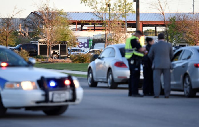 Schertz Police block off Doerr Lane near the scene of a blast at a FedEx facility in Schertz