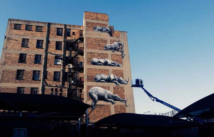 Going wild in the city: Belgian street artist ROA's collection of animals decorate the side of a Jo'burg building