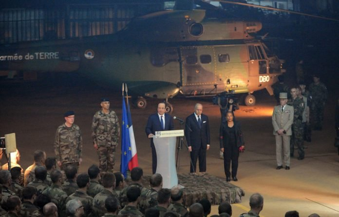 François Hollande speaks to French troops in the Central African Republic on December 10.