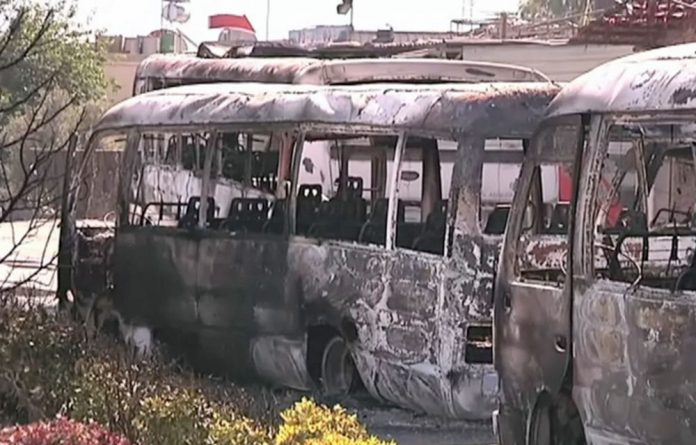 A video image from the UN observer mission in Syria apparently shows damaged buses after overnight fighting in Damascus.