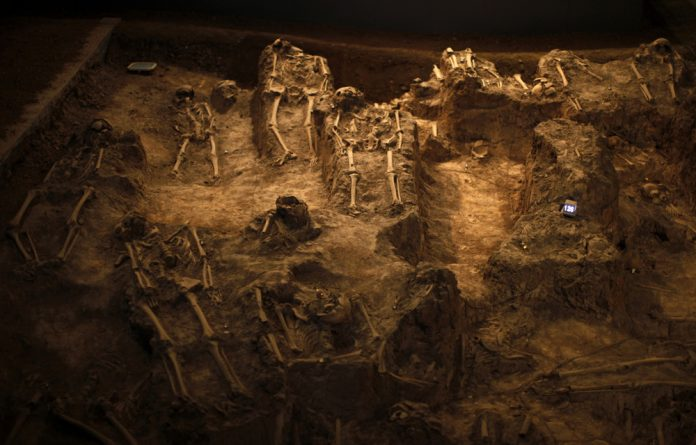 Skeletons of victims of the Nanjing Massacre are seen at the Nanjing Massacre Museum