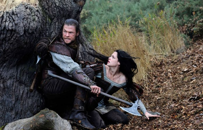 Babes in the wood: Chris Hemsworth and Kristen Stewart in Snow White and the Huntsman.