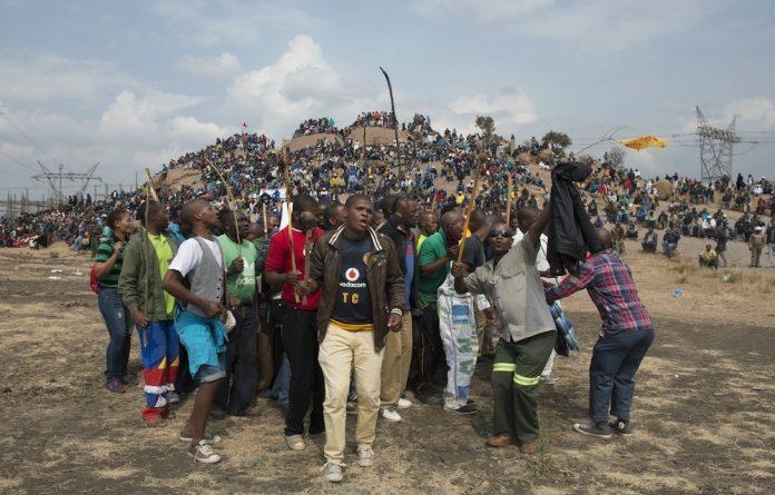 Miners gather at the historic Marikana koppie on the second anniversary of the massacre.