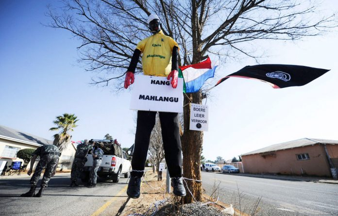 An effigy of Chris Mahlangu hangs outside as he and his co-accused Patrick Ndlovu appear in court for sentencing on the murder of AWB Leader Eugene Terre'blanche.