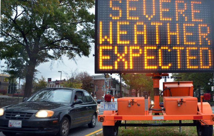 A road sign warns drivers of weather conditions ahead of Hurricane Sandy's landfall.