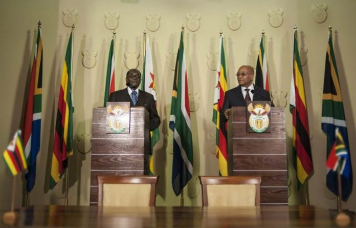 Zimbabwean president Robert Mugabe with his South African counterpart Jacob Zuma.