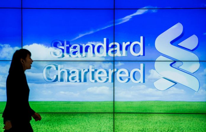 Standard Chartered's market value has slumped almost a quarter after US regulators alleged it hid $250-billion in transactions with Iran.