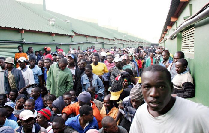 Ilegal immigrants are transported from the Lindela Repatriation Centre to Zimbabwe.