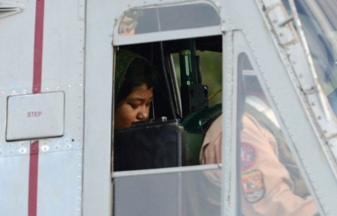 Rimsha Masih sits in helicopter after her release from jail in Rawalpindi on September 8