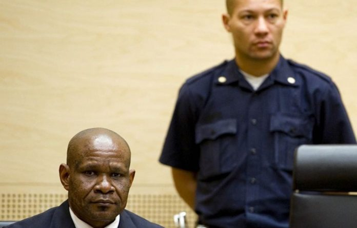 Congolese ex-militia boss Mathieu Ngudjolo Chui listens to the verdict on his trial at the International Criminal Court