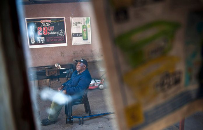 Shebeen owner Malefane 'Dutch' Kopa says the requirement that smokers be 10m from a door or window is impossible in townships – his neighbour is less than 5m away.