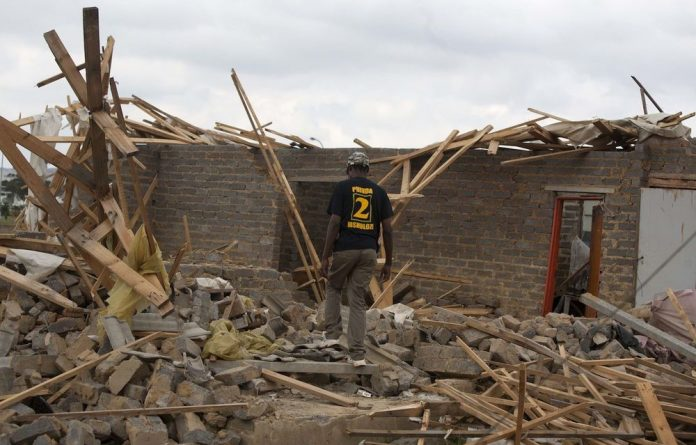 Over 100 illegally built homes are being demolished by police in Lenasia.