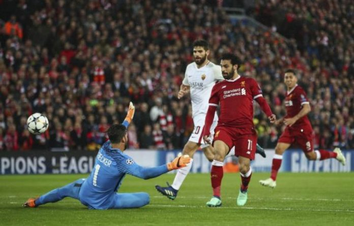 Liverpool's Mohamed Salah scores his side's second goal against Roma at Anfield this week.