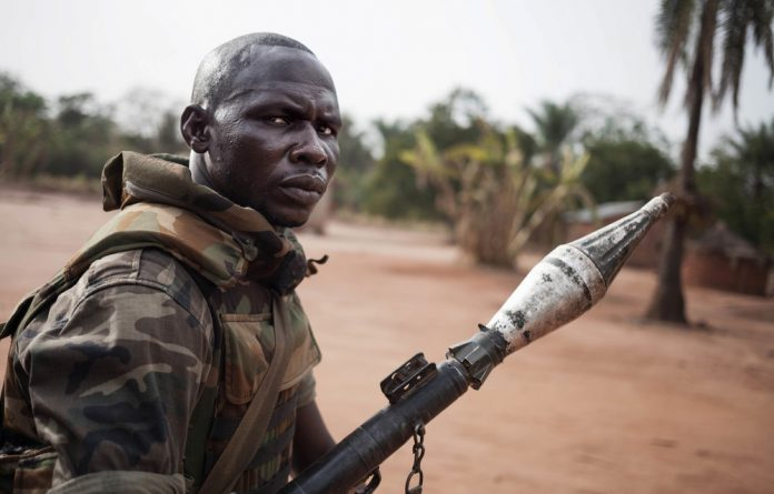 Civil war: Fighting between different militias has hit citizens in the Central African Republic hard. This soldier is with the Central African Armed Forces in the east of the country. Photo: Florent Vergnes/AFP
