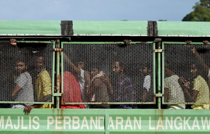 Malaysia and Indonesia on Wednesday announced their countries would end a much-condemned policy of turning away boatloads of starving migrants.