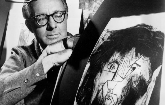 Science fiction writer Ray Bradbury looks at a picture that was part of a school project to illustrate characters in one of his dramas.
