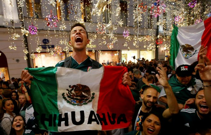 Mexico's fans celebrate victory of their team after the match against Germany.