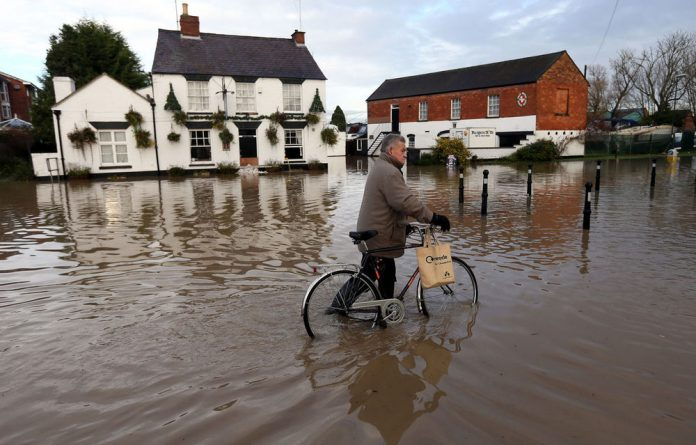 Heavy rain and strong winds battered areas of Britain over the weekend